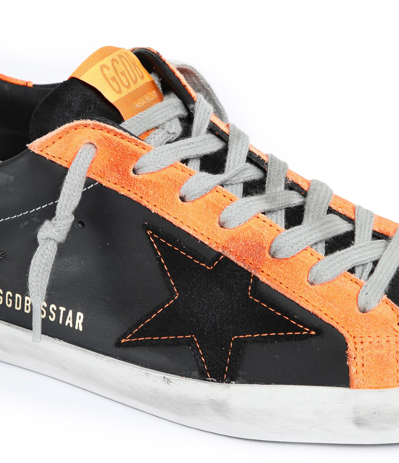 GOLDEN GOOSE - Baskets Homme Superstar Cuir Noir Orange Fluo
